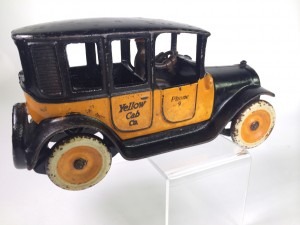 Yellow Cab Co.-call number 9. Cast Iron toy by Arcade.