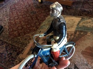 Old toy motorcycle picture.