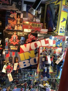 a Beautiful tin toy assortment along with diecast were on display at Mandarake, within Tokyo Japan