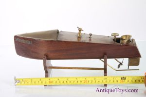 Mahogany windup toy boat from America with brass