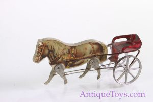 Old Toy picture of a Gibbs wood and tin horse toy with carriage