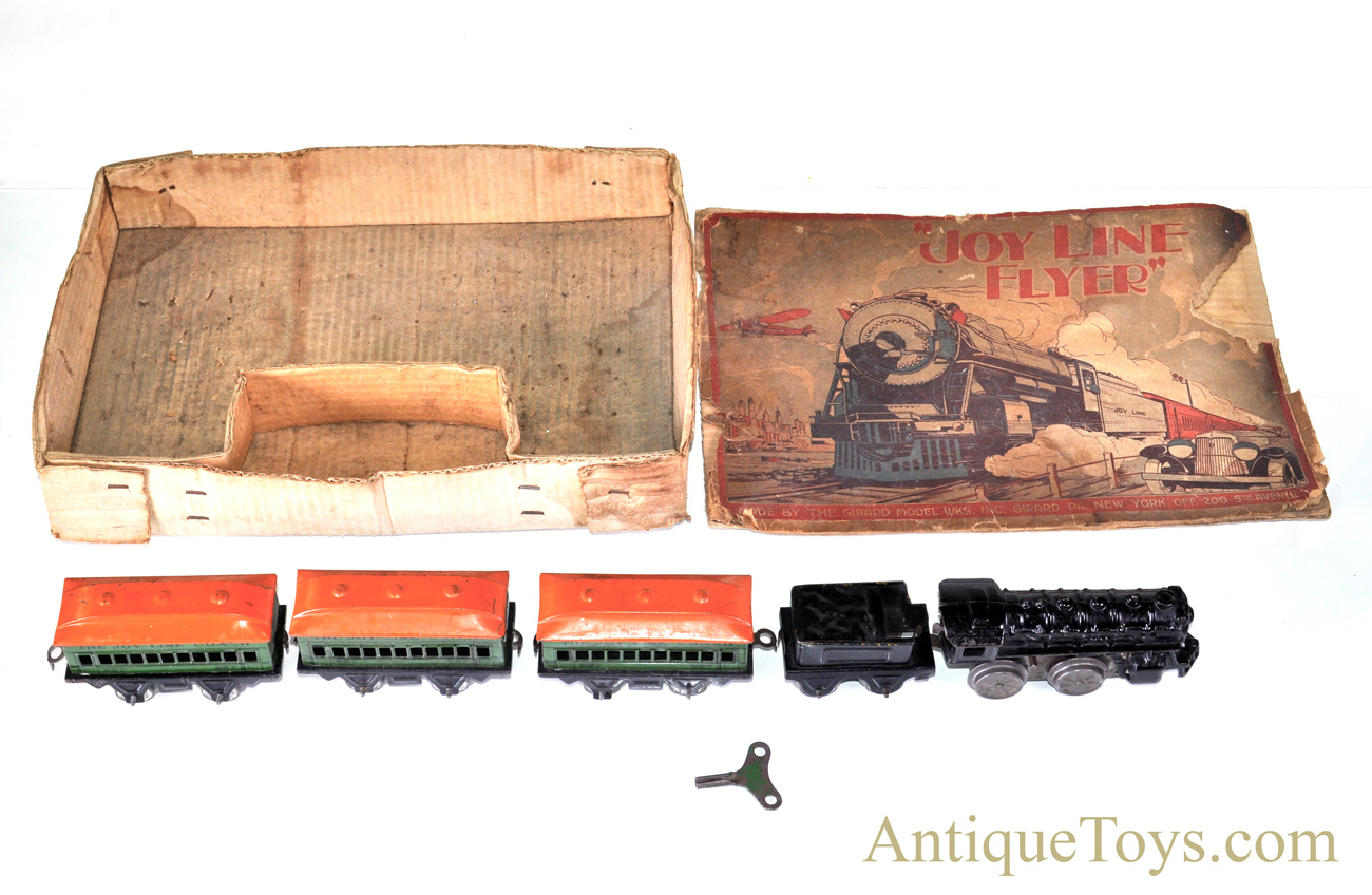 """Girard Joy Line Flyer """"O"""" Gauge Lithograph Wind Up Cast Iron Locomotive  with #357 Tin Coach Train Cars and Box for Sale"""